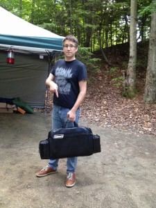 The case holds the stove and two propane canisters.