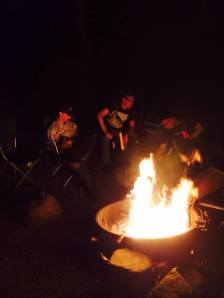 Gathered around the fire, we tell ghost stories.